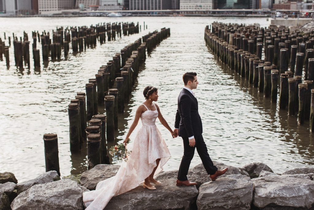 Wedding Photo, A Couple Walking along the DUMBO waterfront by the Brooklyn Bridge