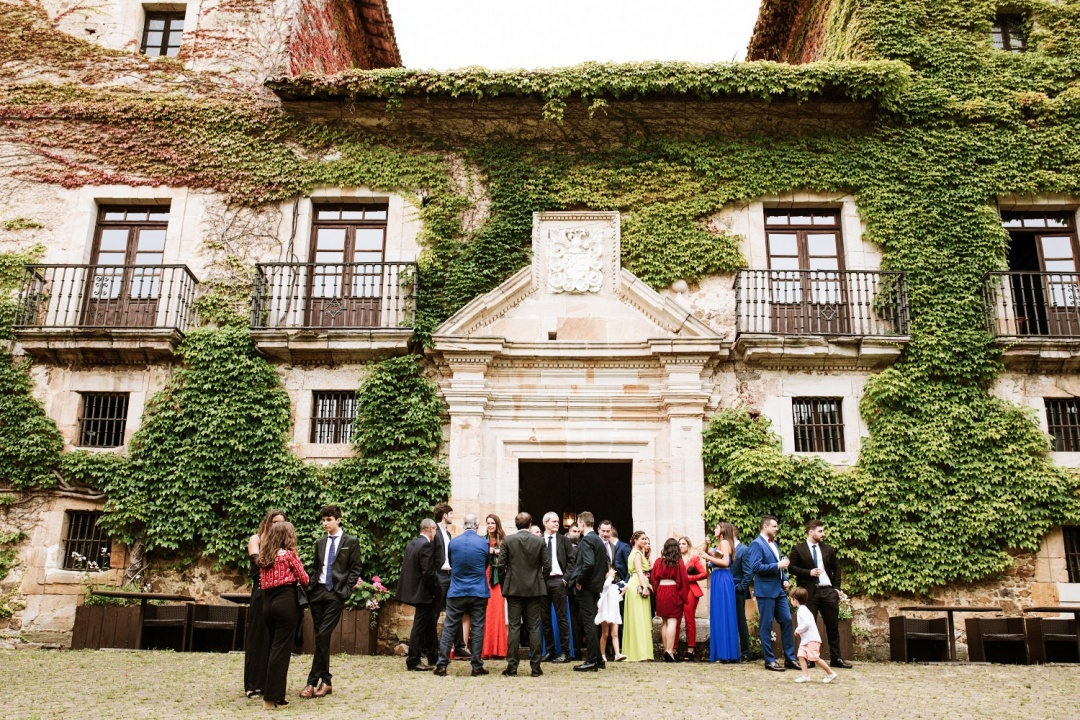Wedding guests gather outside the antique villa in Asturias Spain