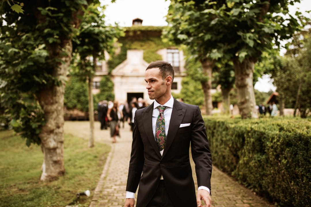 Groom walks towards church for his wedding
