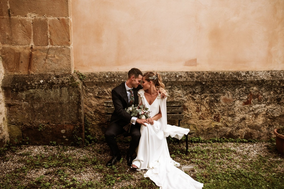 Bride and groom sit and touch foreheads at their Asturias wedding in Spain