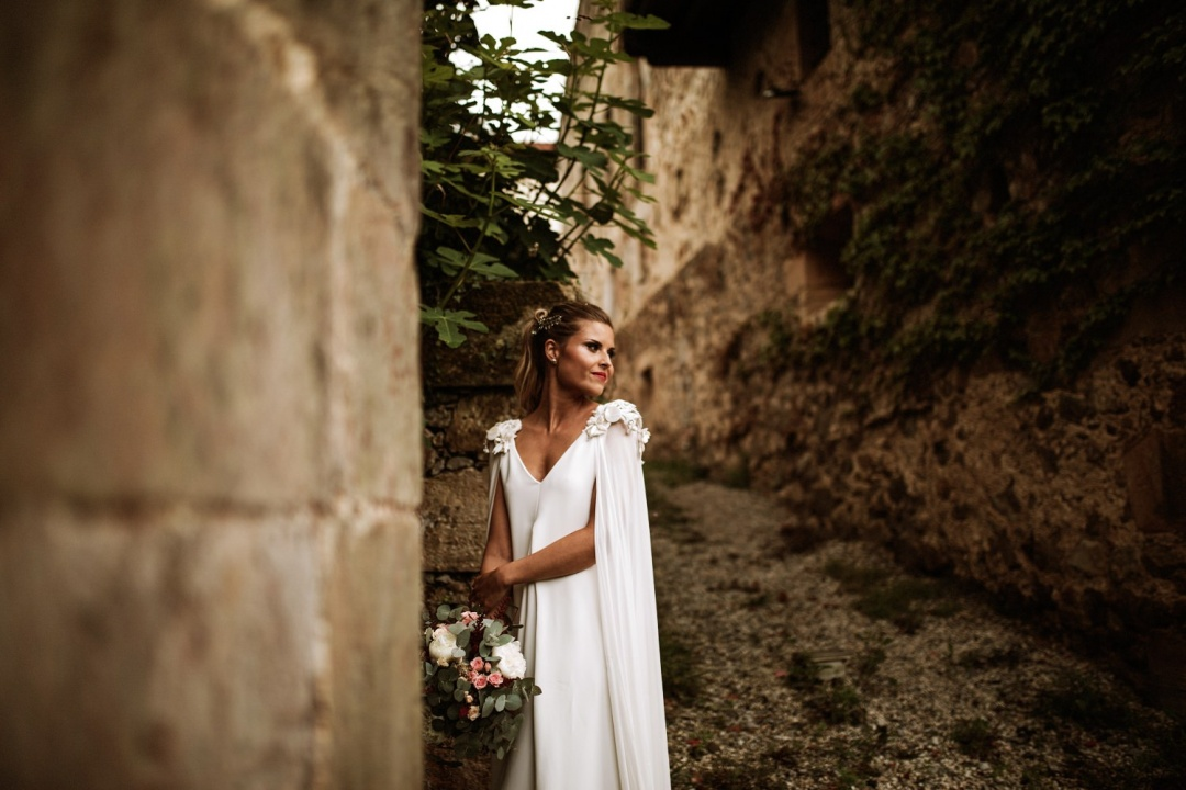 A beautiful bride stands for her portrait at her wedding in Asturias