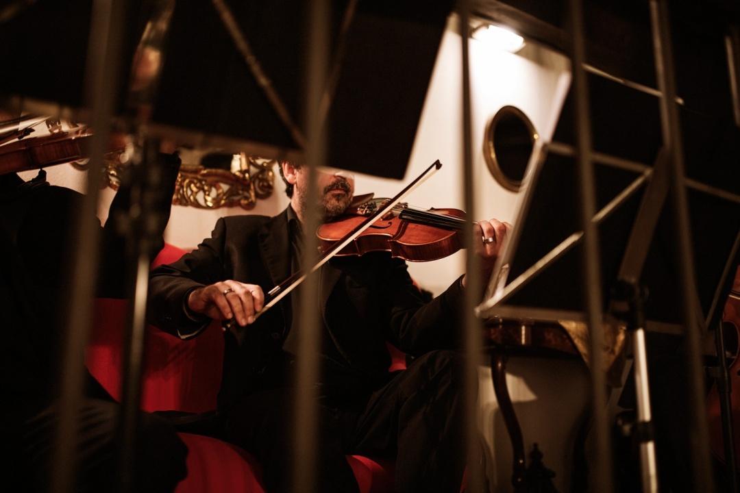 Violins play at the wedding reception in Asturias Spain