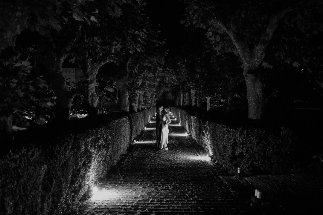 Black and white photo of bride and groom at night at the wedding reception
