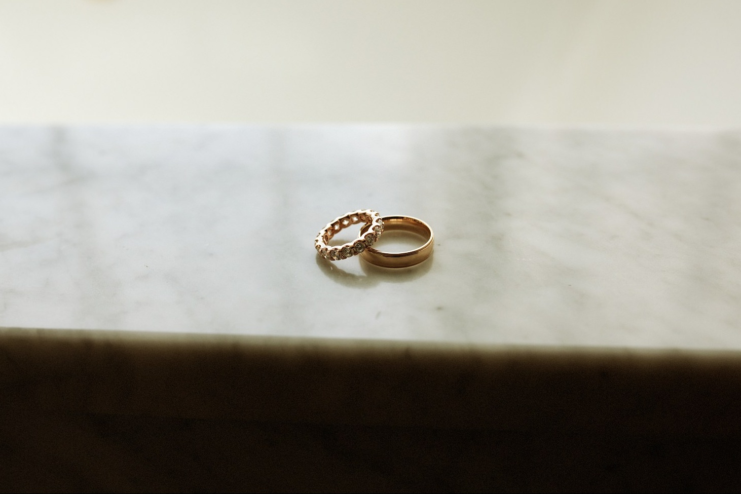 Ludlow Hotel Wedding - Wedding Rings on a marble surface