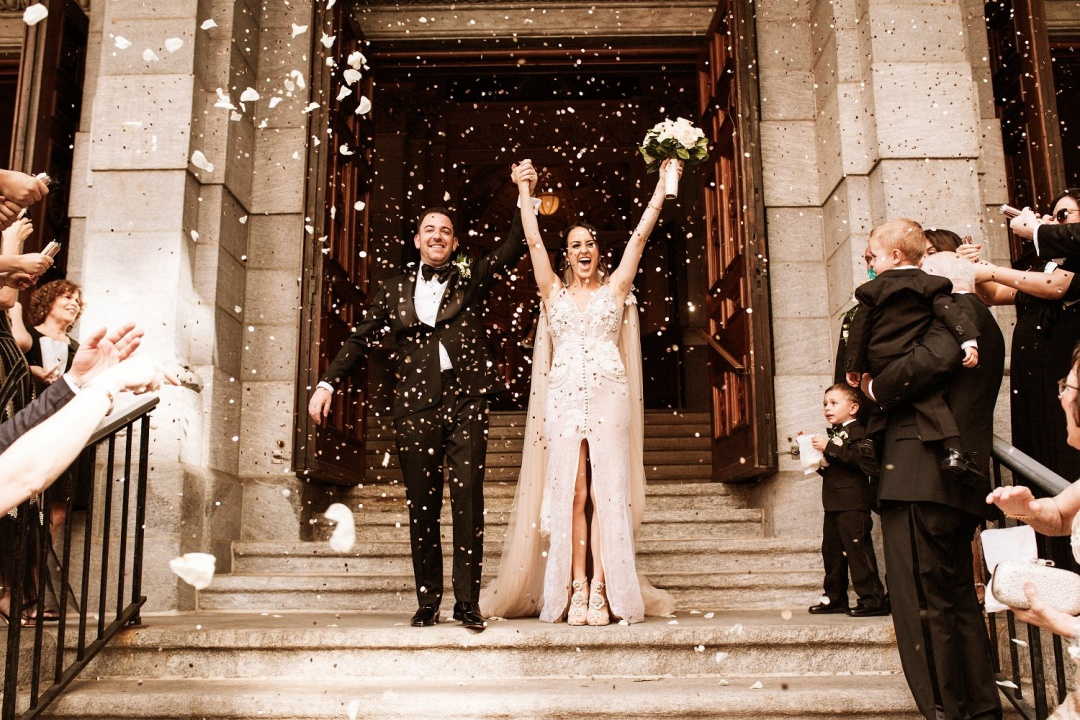 Ludlow Hotel Wedding - An explosion of flowers greets the bride and groom as they exit the church