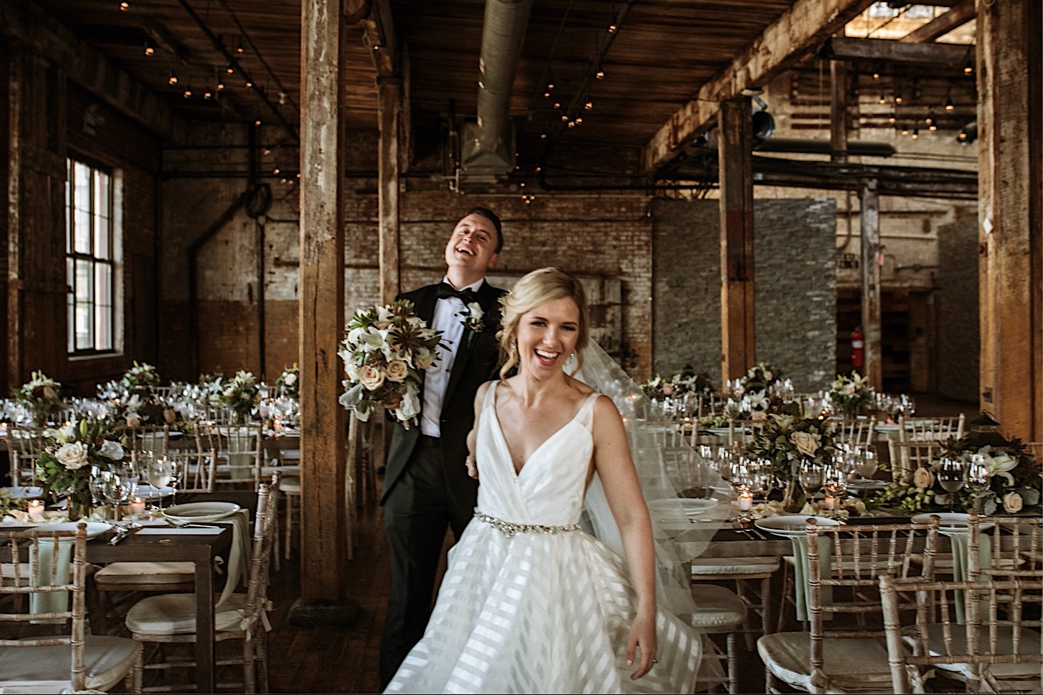 Bride and Groom walk through the reception for photos at Greenpoint Loft