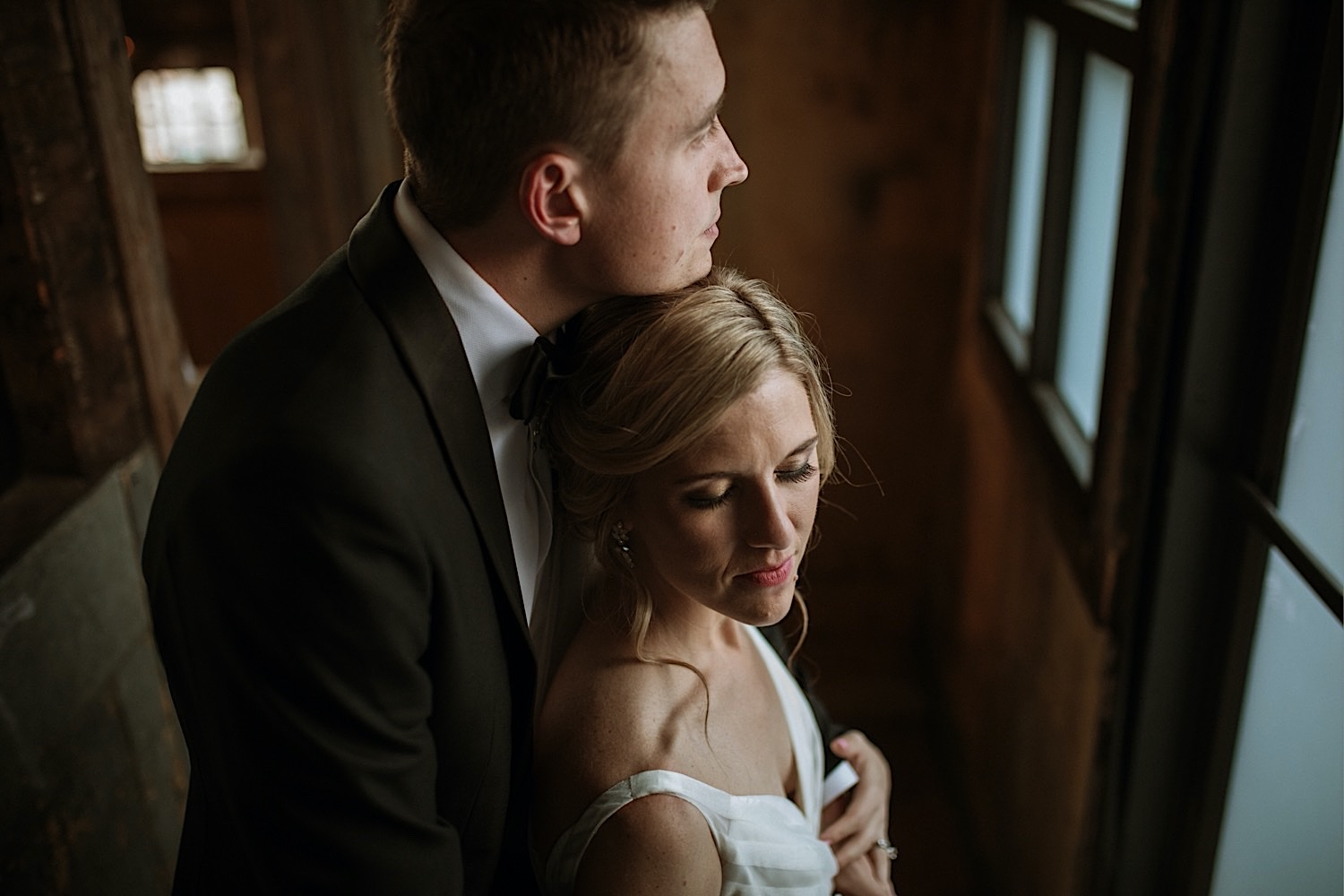 Wedding Photos at the Greenpoint Loft - Bride and Groom in a Stoic Pose Holding Each Other