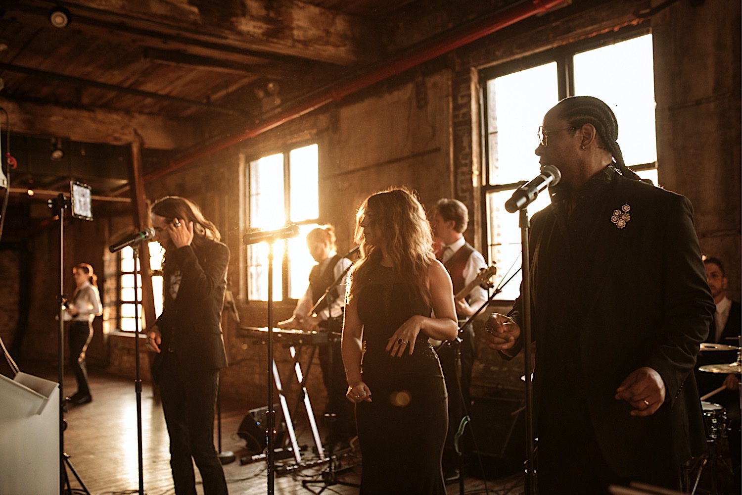 A band plays at sunset at the rooftop wedding venue Greenpoint Loft in Brooklyn NYC