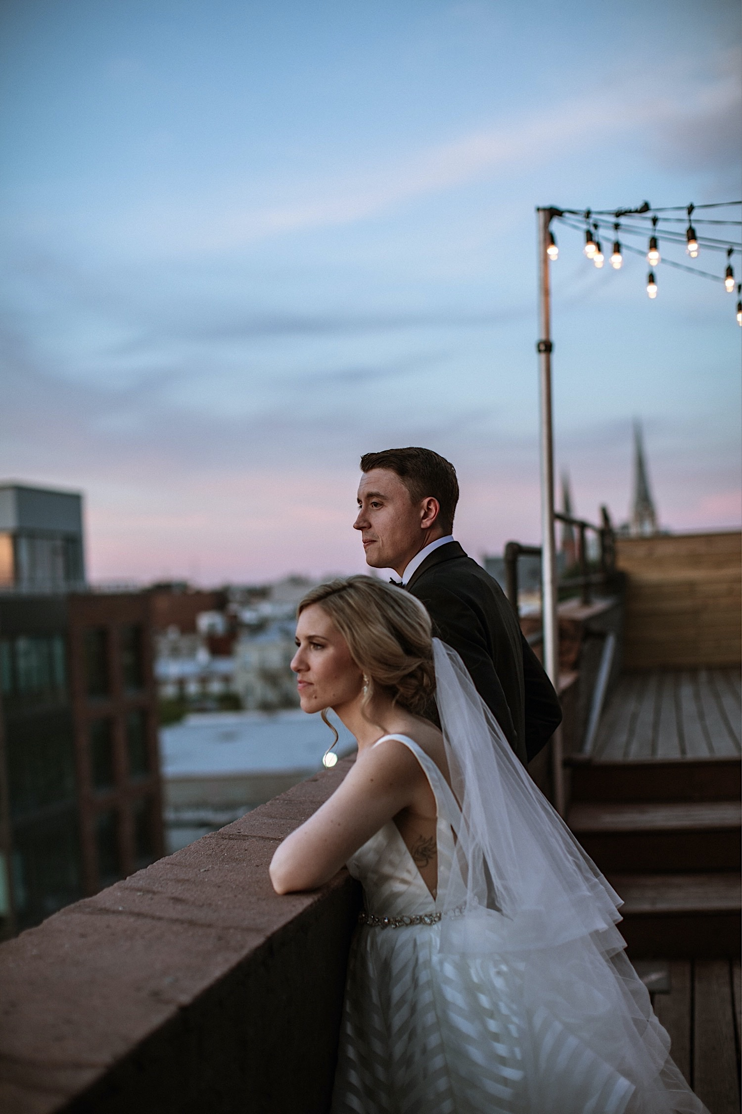 Bride and Groom at sunset on the rooftop of Greenpoint Loft for their wedding
