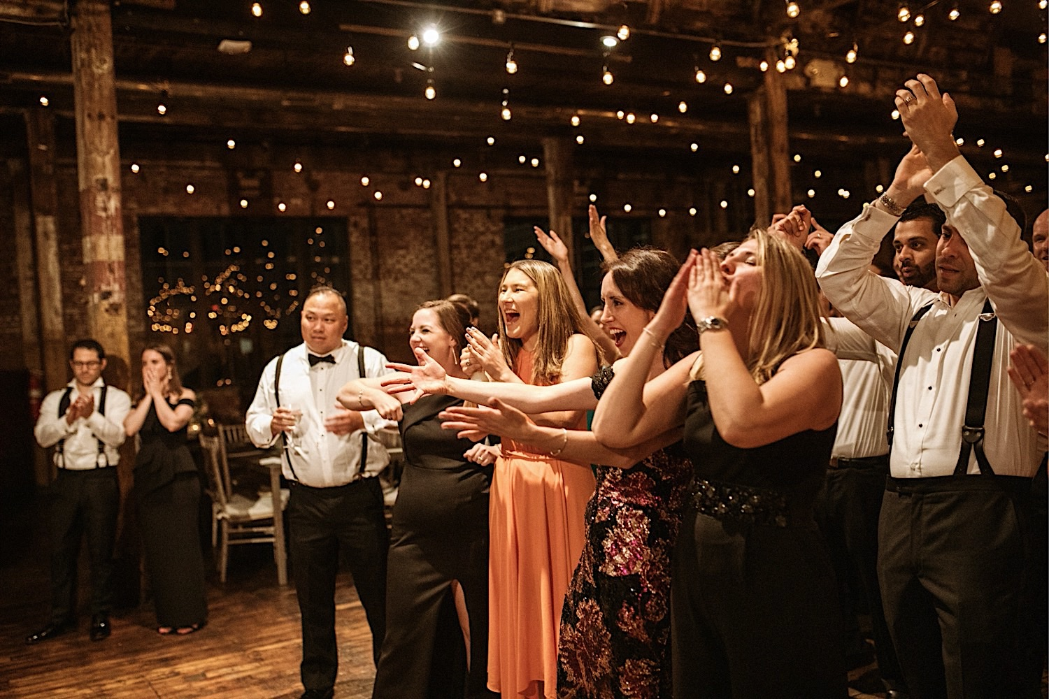Wedding guests cheering at Greenpoint Loft