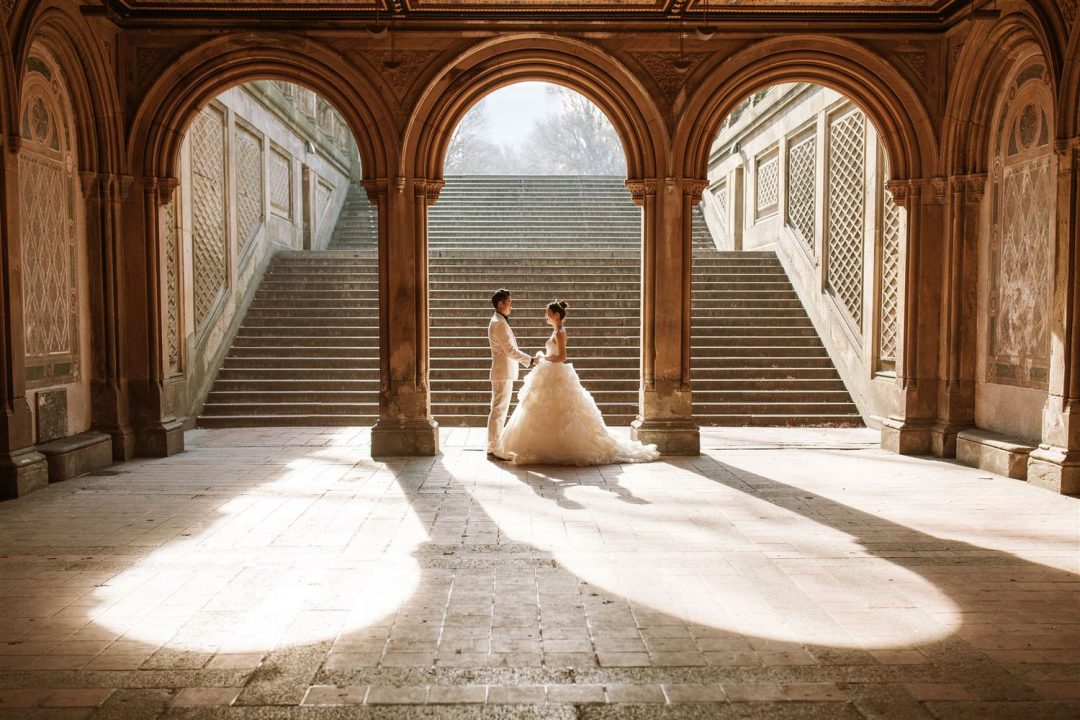 Pre wedding in Central Park New York Bride and Groom pose by the columns under the tunnel at Bethesda Fountain