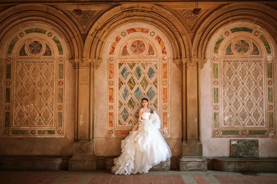 Pre wedding in NYC Bride in Vera Wang Dress Poses in Central Park tunnels at Bethesda fountain