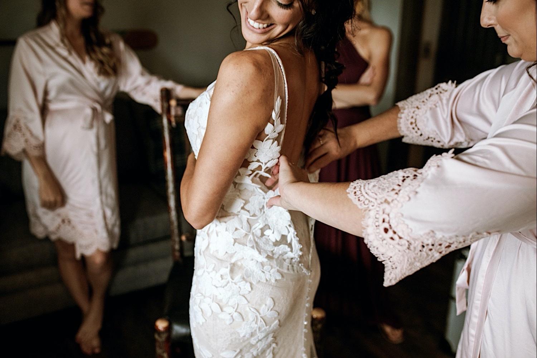 Bomoseen Lodge Wedding - Bride putting on her wedding dress