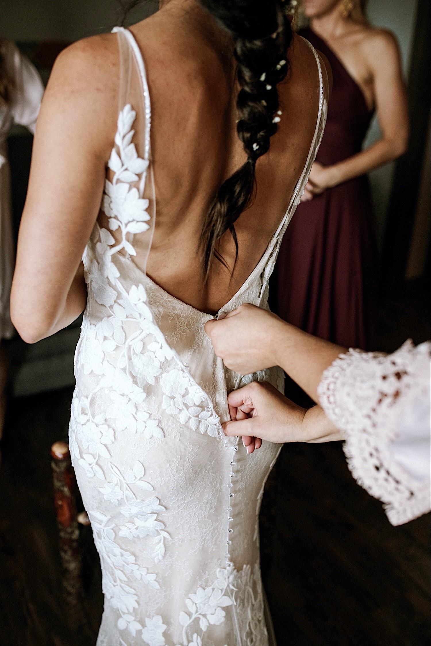 Bomoseen Lodge Wedding - Zipping up the back of bride's wedding dress