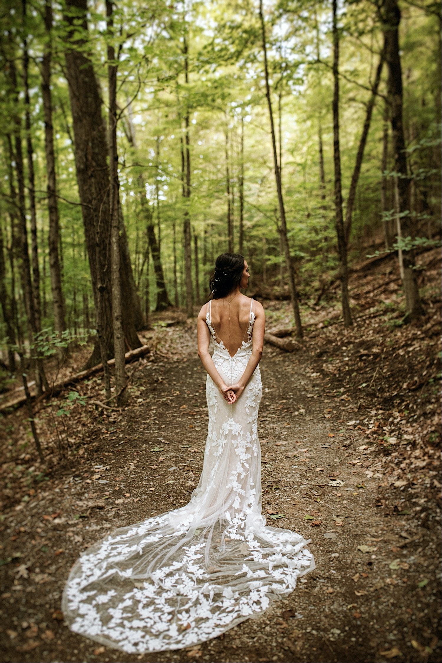 Bomoseen Lodge Wedding - Bridal portrait of a beautiful flowing wedding dress within the forest