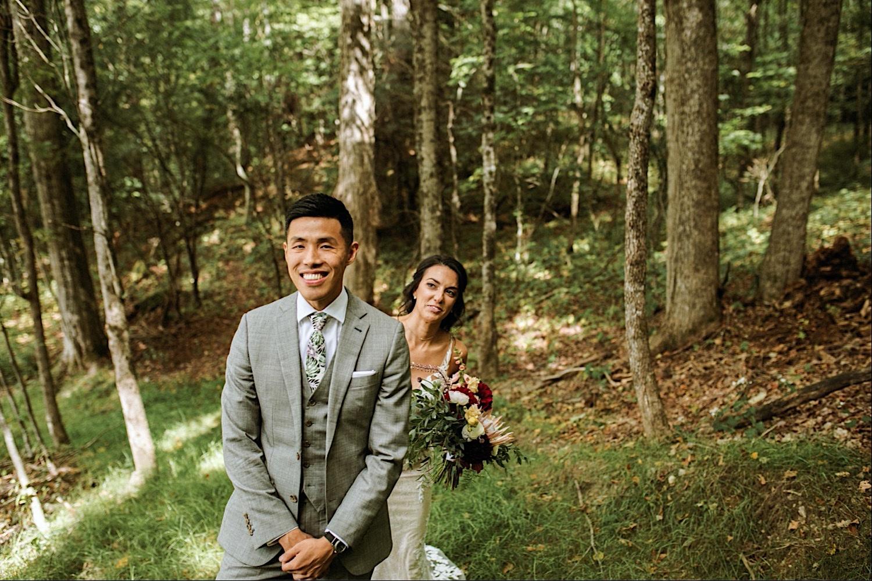 Bomoseen Lodge Wedding - First Look with bride behind groom