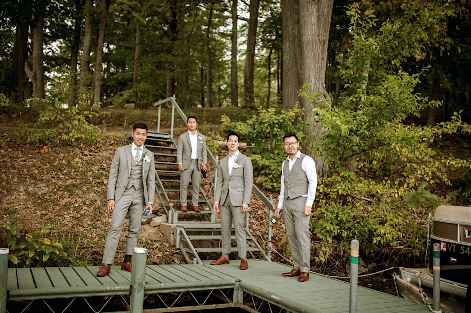 Bomoseen Lodge Wedding - Groomsmen wait for the rest of the wedding party on the dock on Neshobe Island
