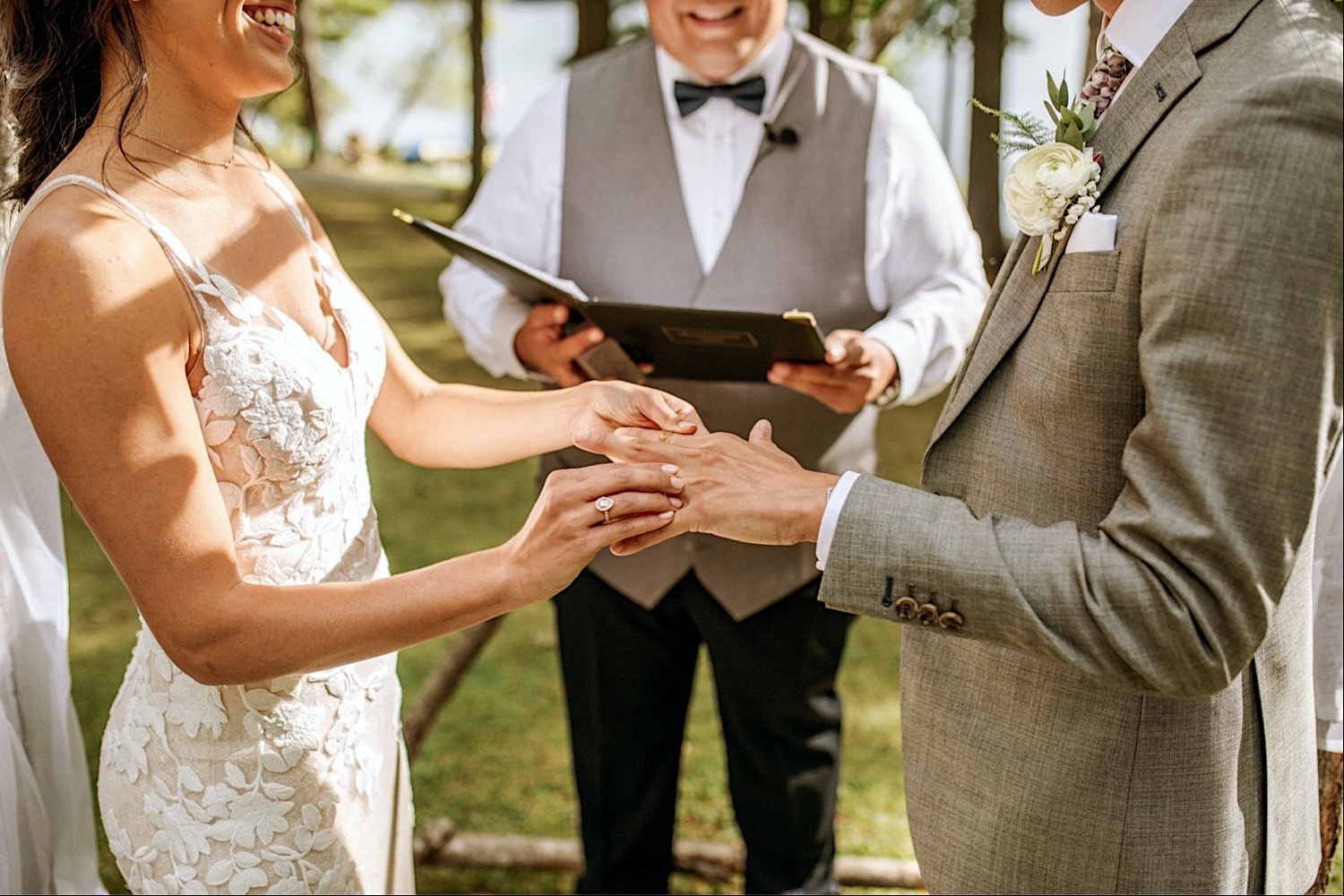 Bomoseen Lodge Wedding - Wedding rings and vows are exchanged during the ceremony