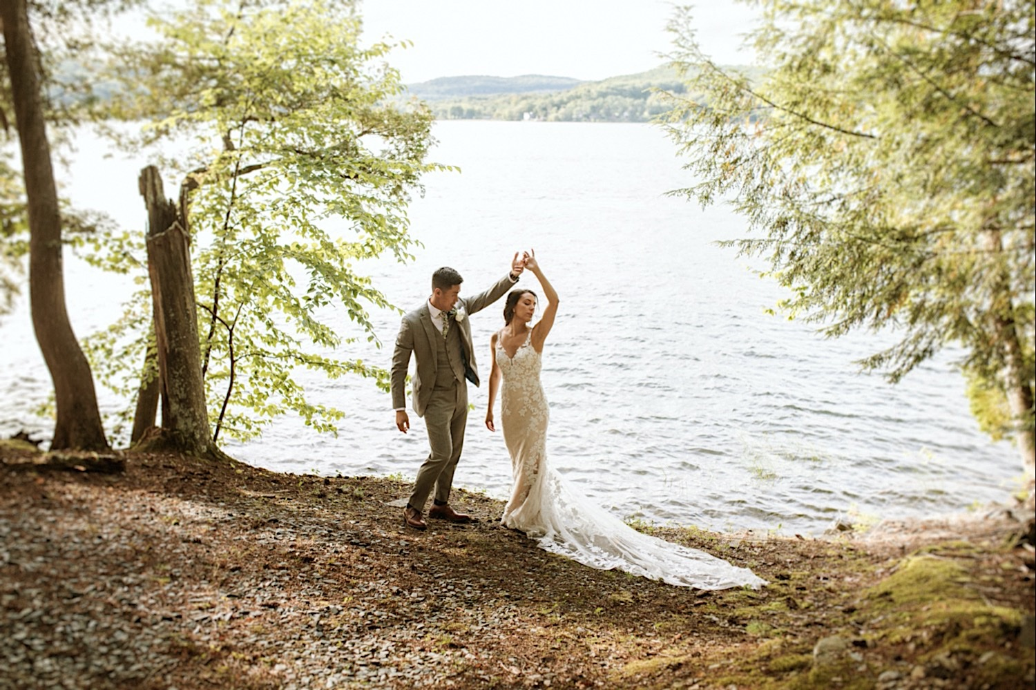 Bomoseen Lodge Wedding - Bride and Groom dance on the lake shore