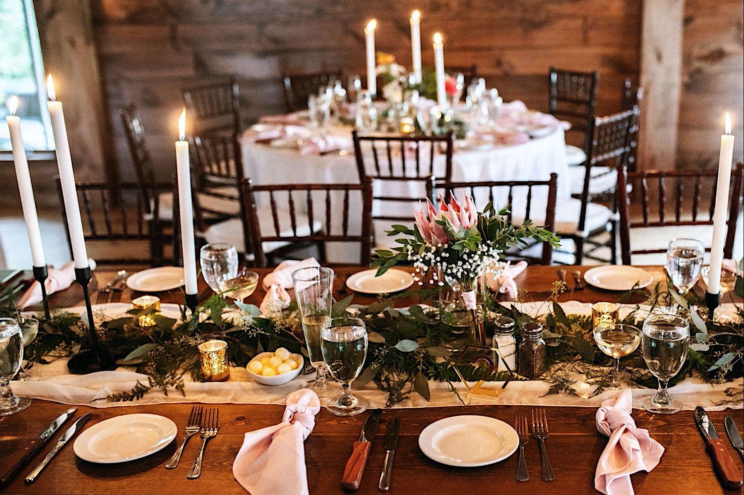 Beautiful tablescape at Bomoseen Lodge with candles, flowers, table runners and themed table settings