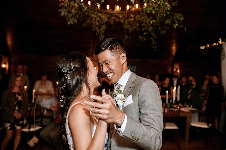 Bomoseen Lodge Wedding - Dancing bride and groom at the reception. Groom smiles at bride
