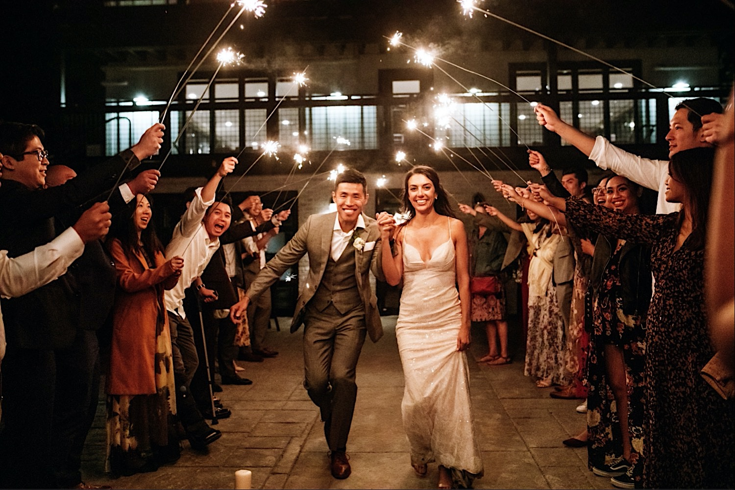 Bomoseen Lodge Wedding Venue - Bride and groom run out under sparklers as they exit their reception
