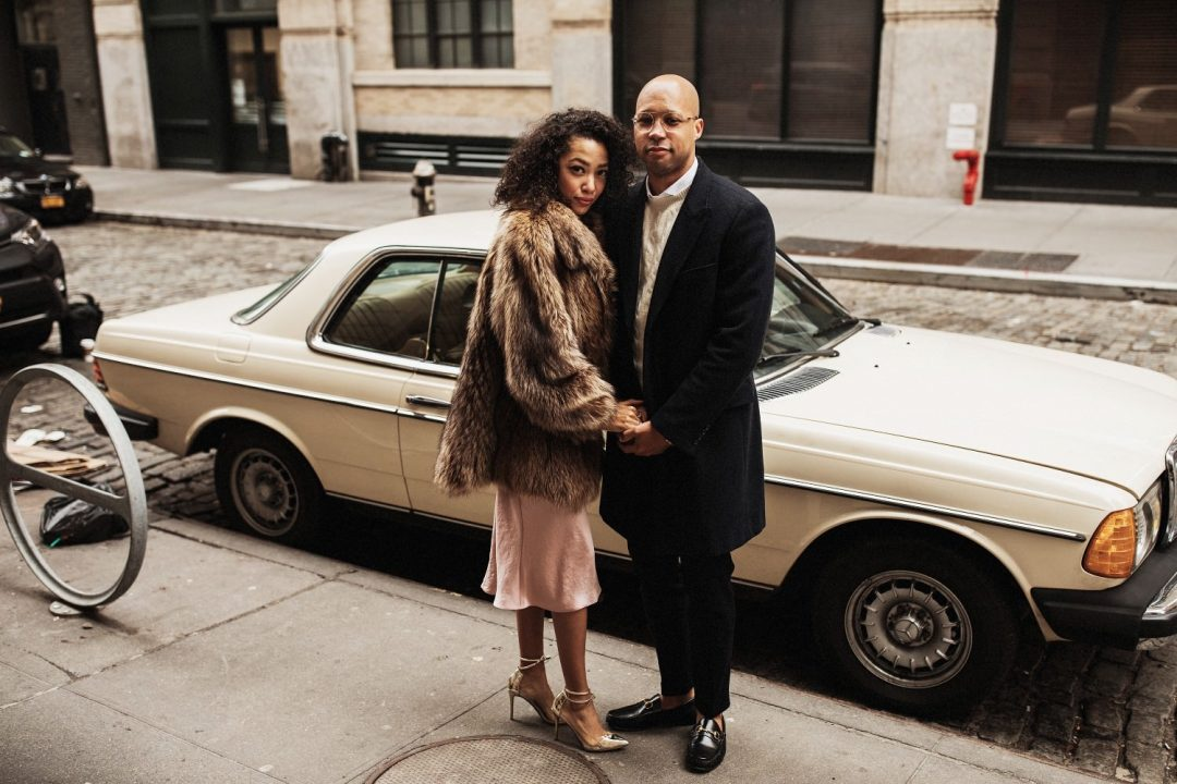 Engagement Session in SoHo NYC - a man and a woman stand together with a vintage car in the backdrop