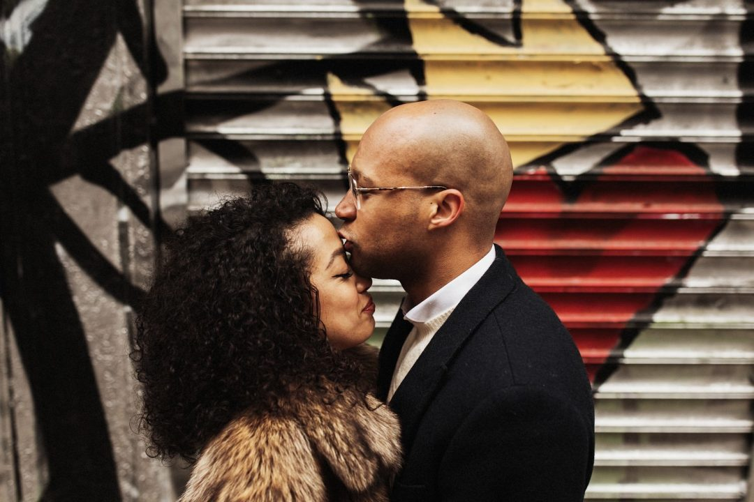 Man kisses his fiance on the forehead in SoHo NYC during their Engagement Session