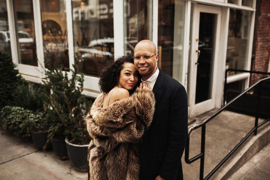 Smiling styling couple in their SoHo engagement session in New York City