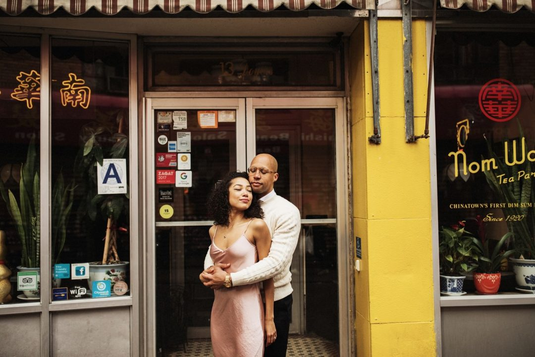 Couple stands for a engagement photo in Chinatown at the Nom Wah Tea Parlor