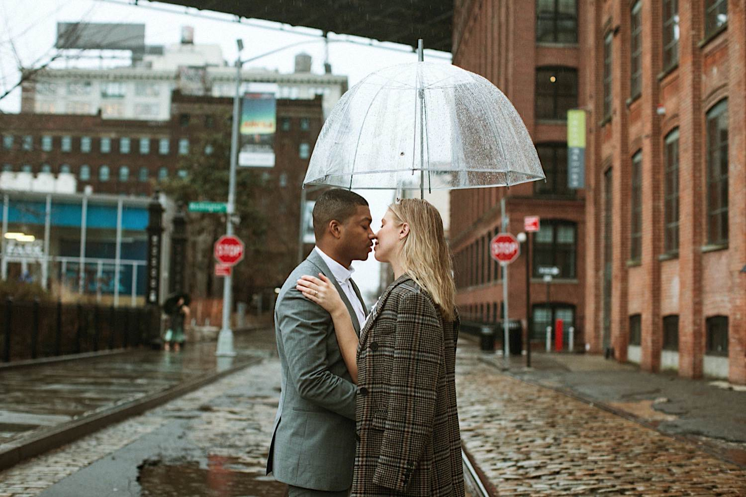 DUMBO Wedding Photos - A couple under their umbrella in the rain