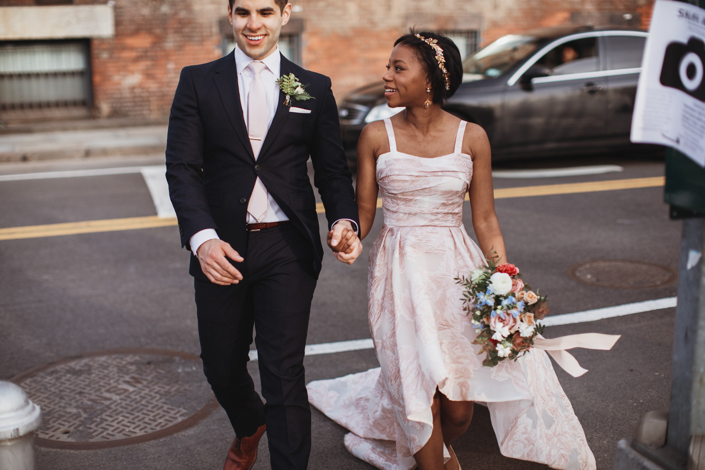 Couple crosses the street for their wedding photos in DUMBO Brooklyn