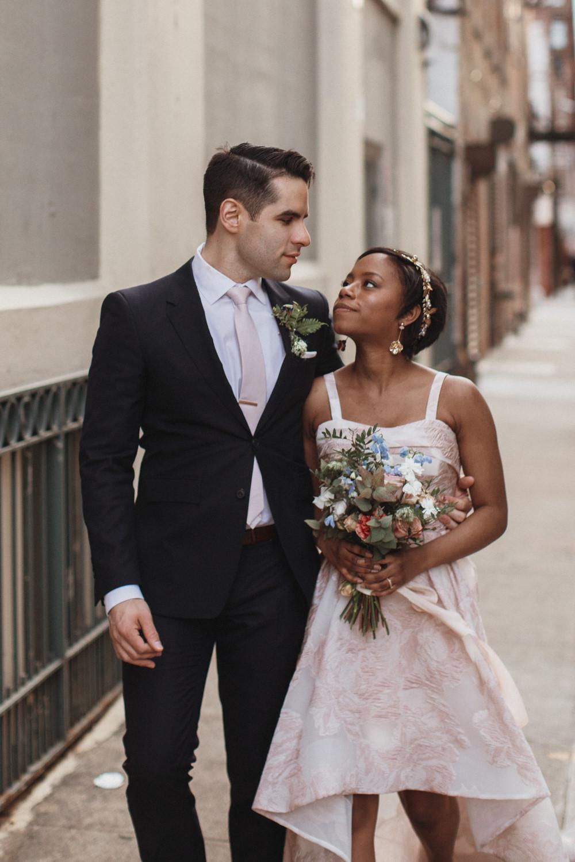 Couple walking through DUMBO Brooklyn for wedding photos