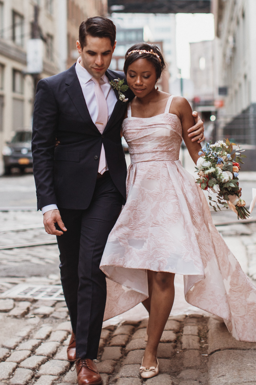 Wedding Photos - Bride and Groom walks down cobblestone streets in DUMBO