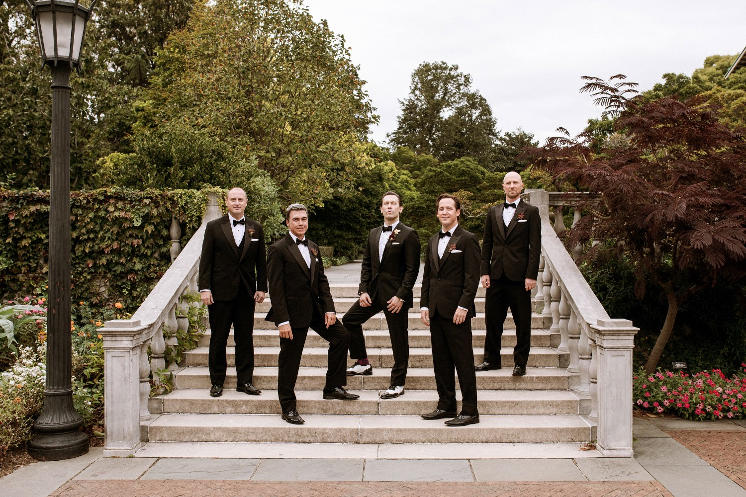 Wedding Party poses by the stairs at the Brooklyn Botanic Garden