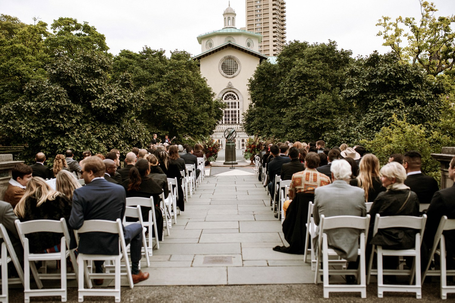 Wedding guests seated at the Magnolia Plaza for the ceremony at the Brooklyn Botanic Garden