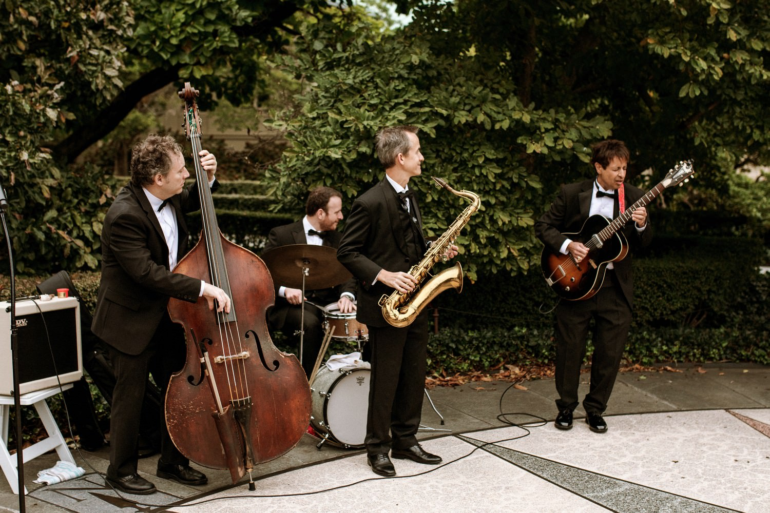 A live band plays at the wedding ceremony at the Brooklyn Botanic Garden