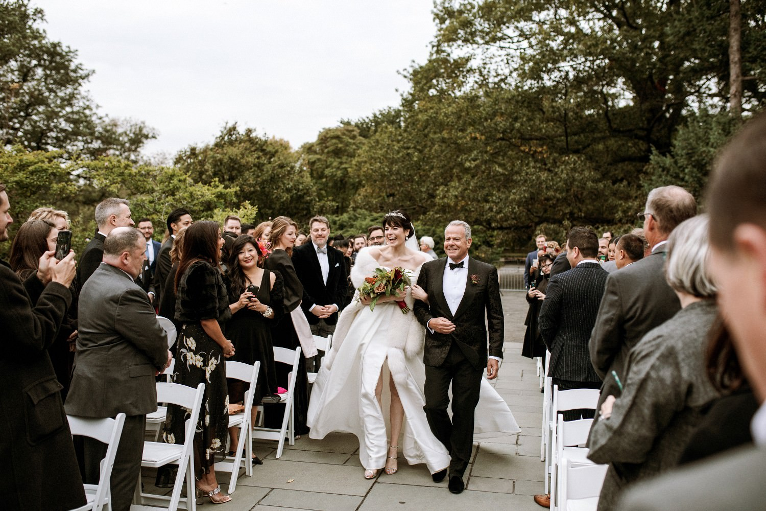 Father walks his daughter down the aisle at a wedding at the Brooklyn Botanic Garden