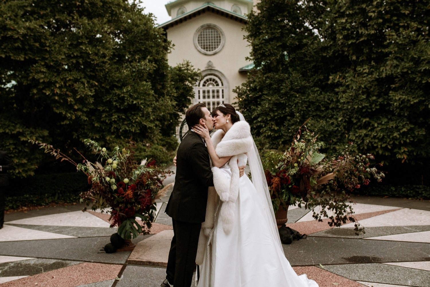 Wedding photography - Couple's first kiss after their wedding vows at the Brooklyn Botanic Garden