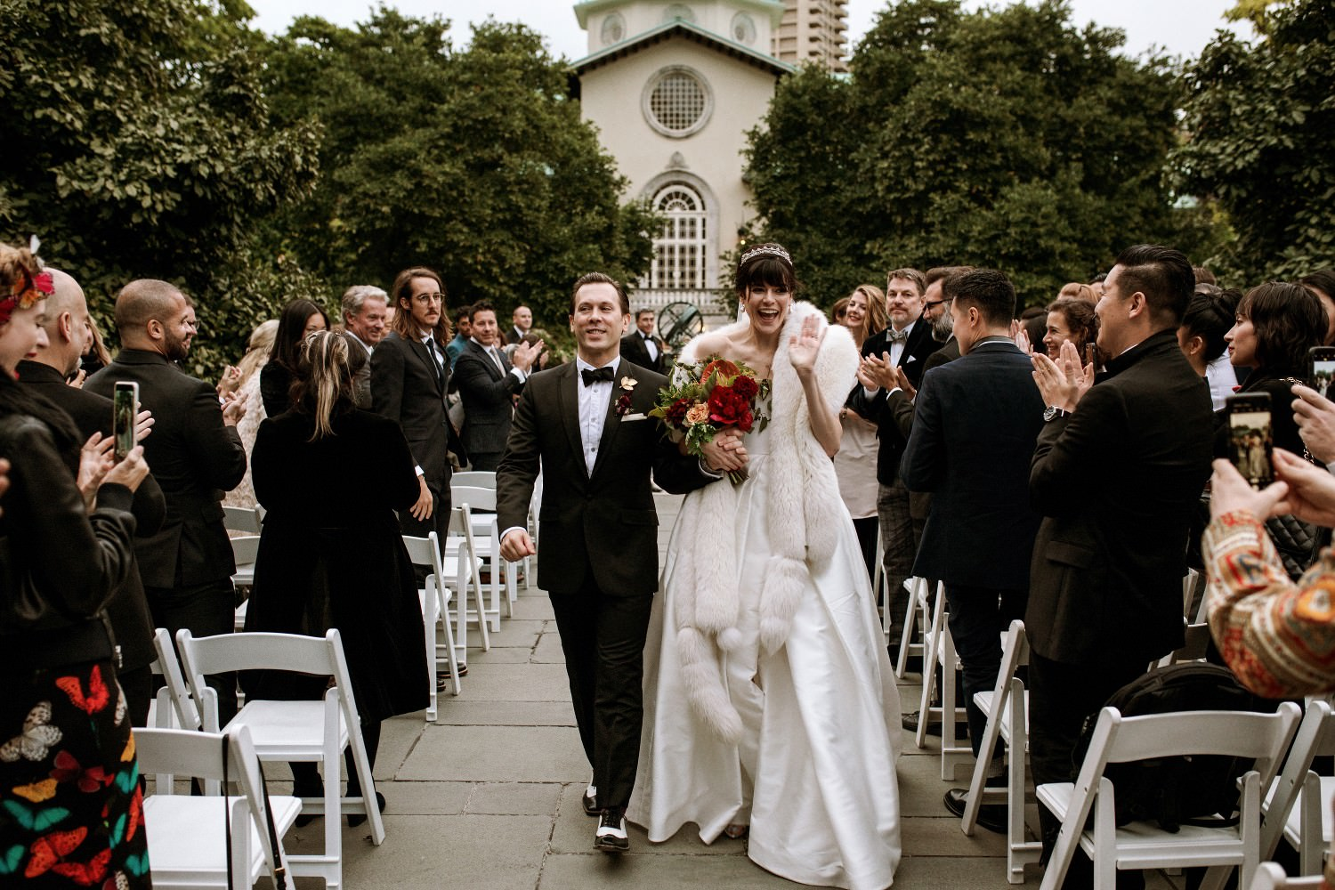 Wedding couple walks down the aisle after their wedding ceremony at the Brooklyn Botanic Garden