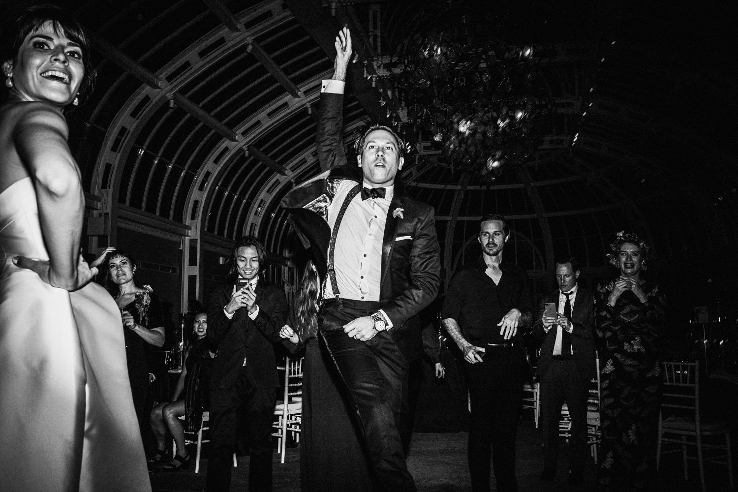 Groom dances to live music at the wedding reception in the Palm House at the Brooklyn Botanic Garden