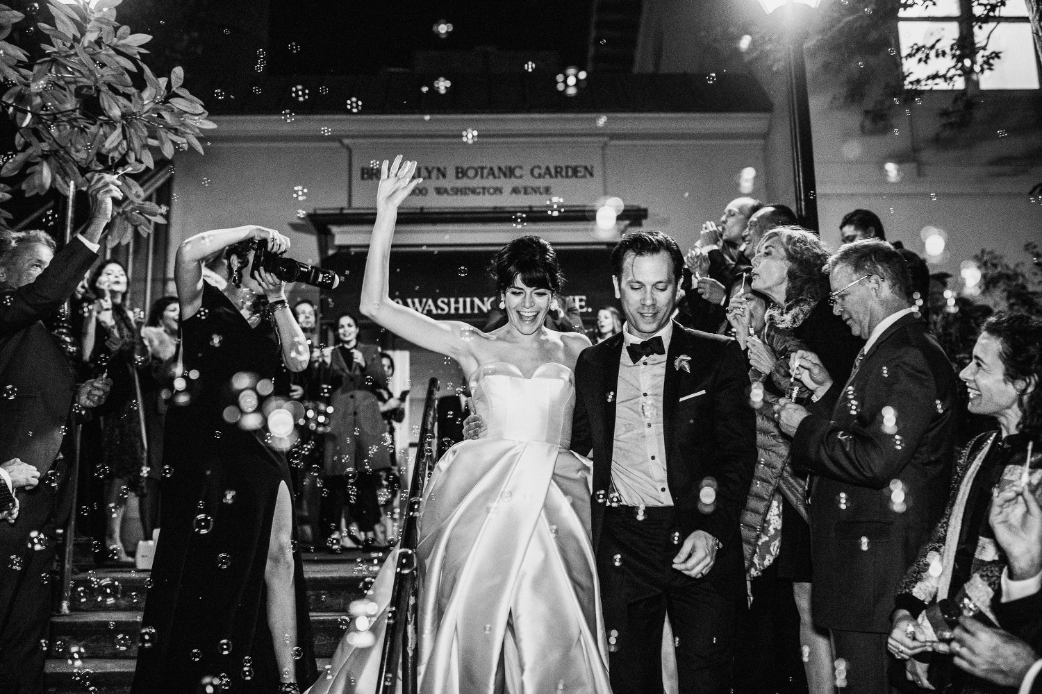 Wedding couple - bride and groom make an exit after their wedding reception at the Brooklyn Botanic