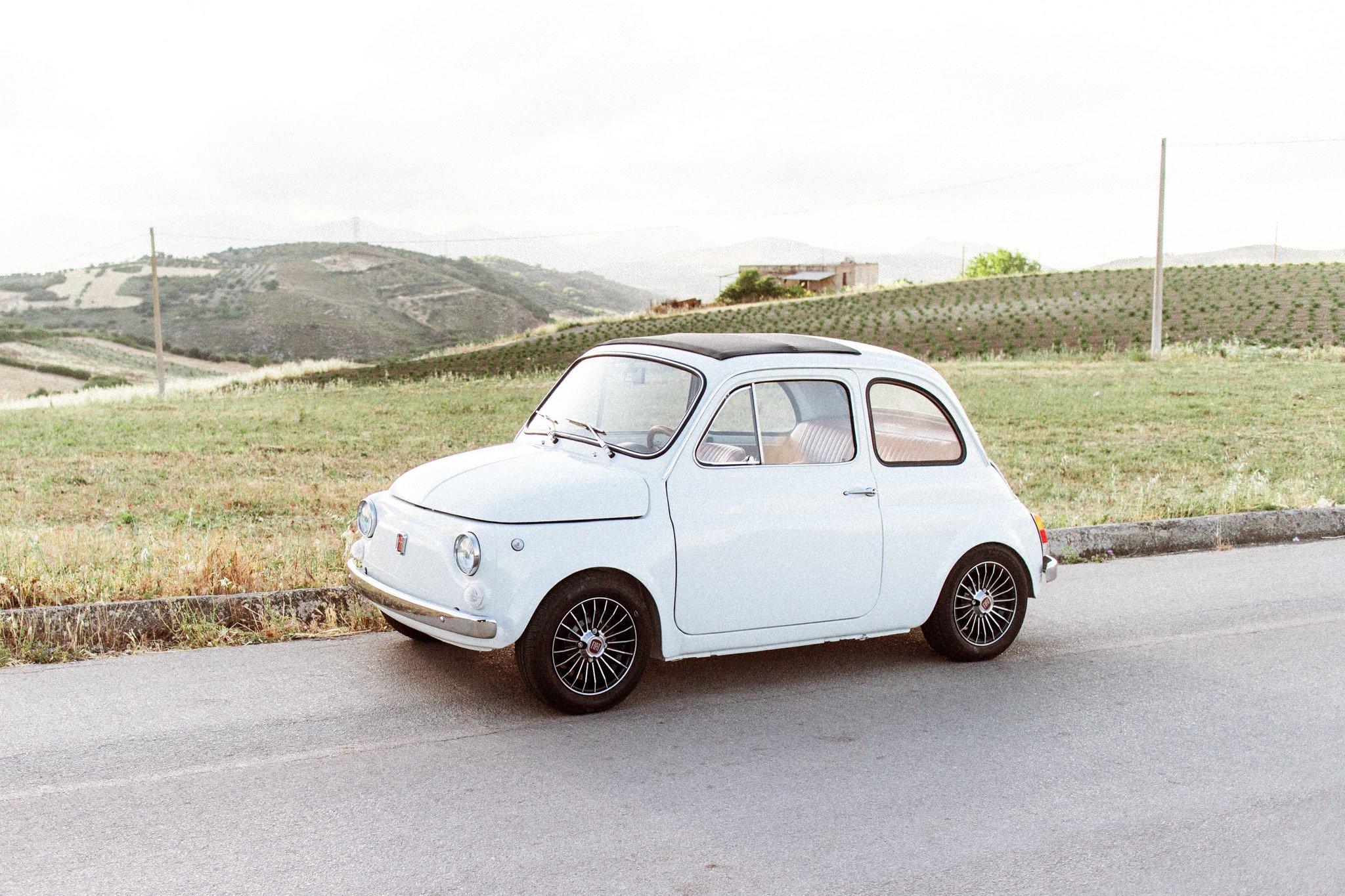 White vintage FIAT 500 for go little car